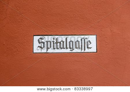 Street Name Spitalgasse Painted On A Wall