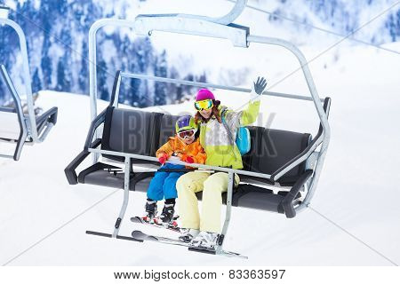 Mother with boy lifting on ski lift