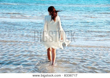 Woman In White Dress At Seaside