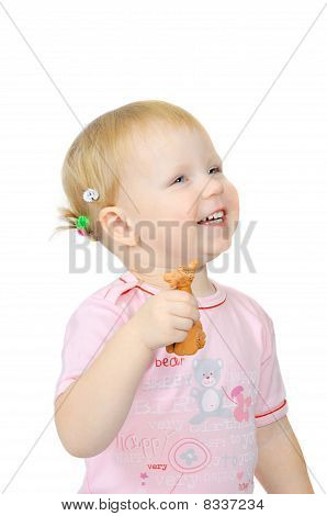 Smiling Young Girl With Toy In Hand