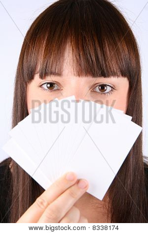 Woman holding blank business cards