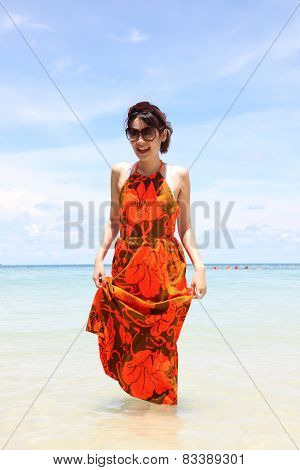 Pretty woman posing in the sea