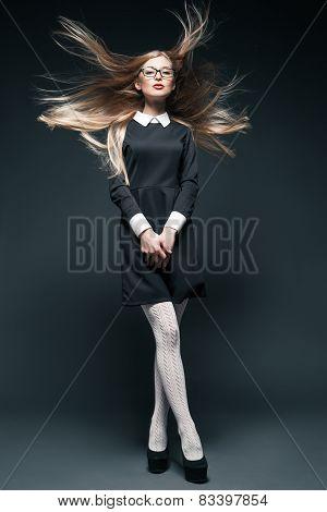 portrait of blonde woman wearing glasses