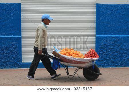 Fruit Vendor On A Street In Cuenca, Ecuador