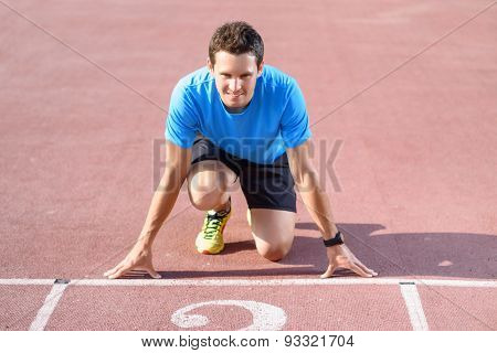 Young sportsman going to run