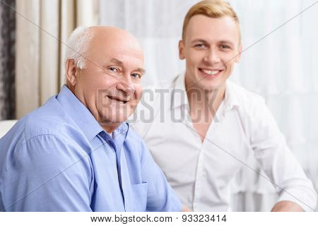 Two smiling men of different ages