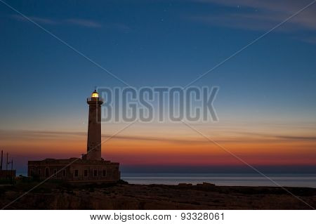 Lighthouse At Dawn