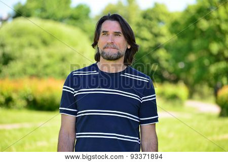Middle Age Man Standing Outdoors