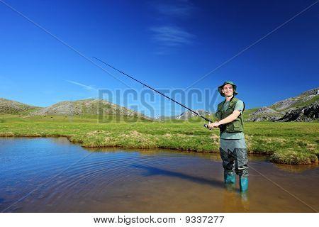 Happy Fisherman Fishing In Mavrovo Region, Macedonia