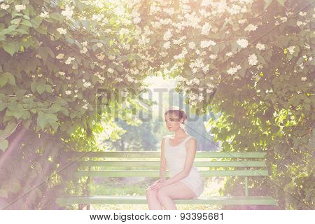beautiful delicate elegant woman bride in white dress with hair and tiara on his head sitting in