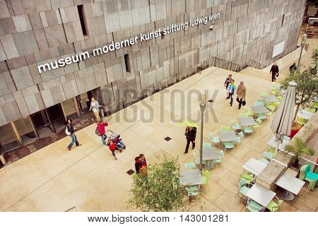 VIENNA, AUSTRIA - JUN 10, 2016: People walking around Museum of Modern Art with outdoor cafe on June 10, 2016. MUseum MOderner Kunst in the Museumsquartier has collections of Andy Warhol and Pablo Picasso