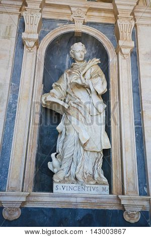 Statue of Saint Vincent of Saragossa also known as Vincent Martyr Vincent of Huesca or Vincent the Deacon patron saint of Lisbon at the Palace of Mafra in Portugal.