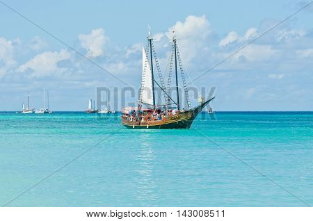 Oranjestad Aruba - December 01 2011: Tourists sailing aboard Jolly Pirates along the coastline and enjoy the beautiful tropical island of Aruba at December 01 2011.