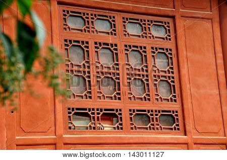 Deyang China - Nobember 5 2009: Intricate wooden window tracery on Qisheng Hall at the Deyang Confucian Temple