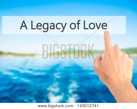 A Legacy Of Love - Hand Pressing A Button On Blurred Background Concept On Visual Screen.