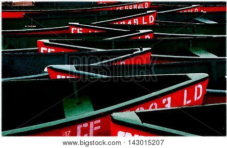 Multiple dark green red numbered wooden boats