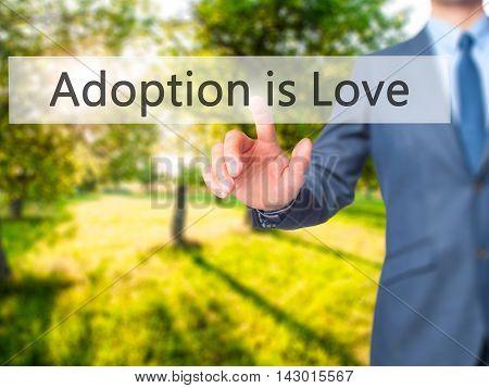 Adoption Is Love -  Businessman Press On Digital Screen.