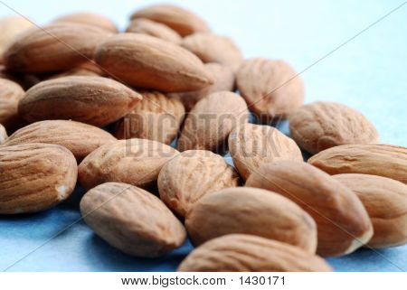 A Pile Of Almonds Against A Blue Background 2