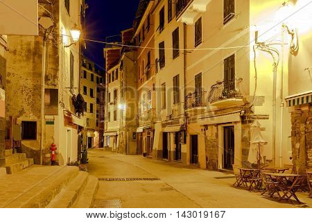 Old, narrow, medieval streets in the Italian village Vernazza at night. Cinque Terre National Park, Liguria, Italy.