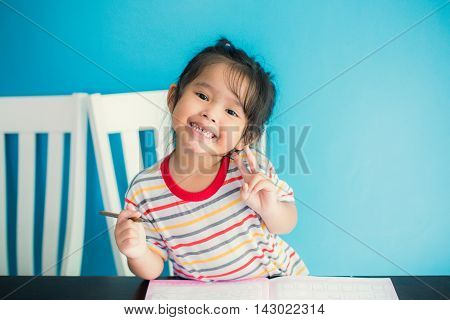 asian young girl children happy doing her homework people, family concept