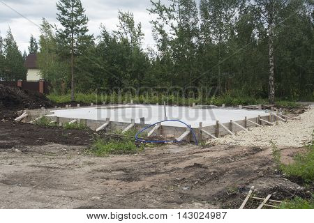 shot of concrete foundation for new rural house