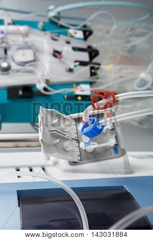 Hemodialysis bloodline tubes connected to hemodialysis machine. Health care blood purification kidney failure transplantation medical equipment concept.