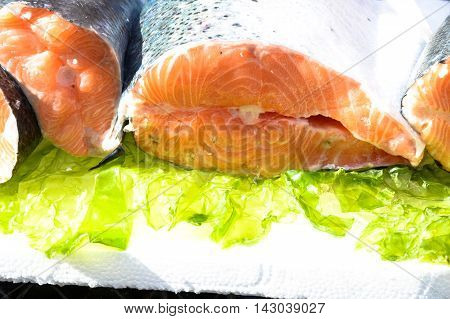 Salmon exposed in street fish market in Italy