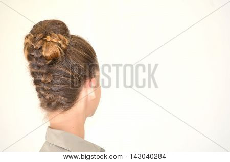Hairstyle with long hair, young model on a white background