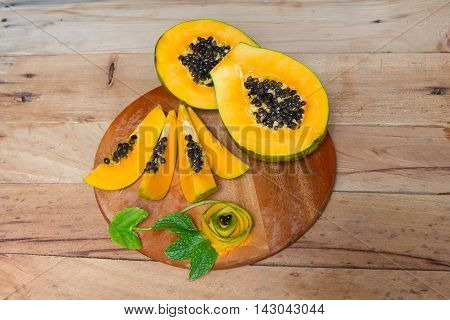 Papaya fruit on wooden background.Sliced fresh papaya.