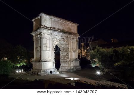 Arch of Titus photographed at night illuminated by artificial lights. Roman masterpiece it is the symbolic monument Flavian era thanks to substantial innovations in both architectural and structural field both in artistic and sculptural field.