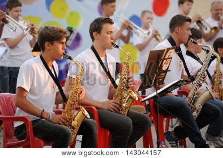 Orel Russia - August 05 2016: Orel city day. Young musicians playing in orchestra horizontal