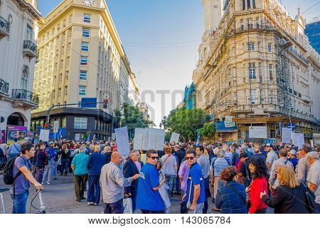 BUENOS AIRES, ARGENTINA - MAY 02, 2016: unidentified people marching and protesting on the street against the massive layoffs.