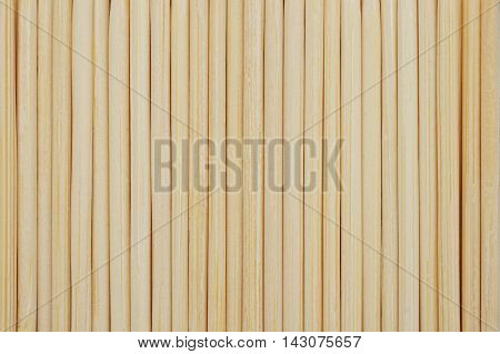 Vertical bamboo toothpicks line up in row