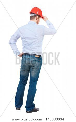 Backview of an engineer in construction helmet stands. Standing young guy. Rear view people collection.  backside view of person.  Isolated over white background. businessman in a white shirt and a