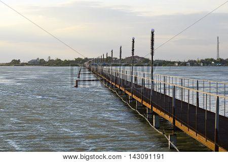Bridge over the beautiful stormy firth in Odessa region near Black Sea, Ukraine