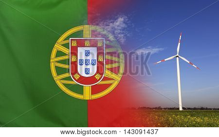 Concept clean energy with flag of Portugal merged with wind turbine in a blue sunny sky and green grass with flowers