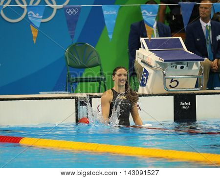 RIO DE JANEIRO, BRAZIL - AUGUST 8, 2016: Katinka Hosszu of Hungary celebrates winning gold in the Women's 100m backstroke Final of the Rio 2016 Olympic Games at the Olympic Aquatics Stadium