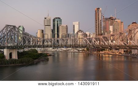 Skyline Brisbane and Story Bridge day and sunrise transistion at the golden coast in Australia