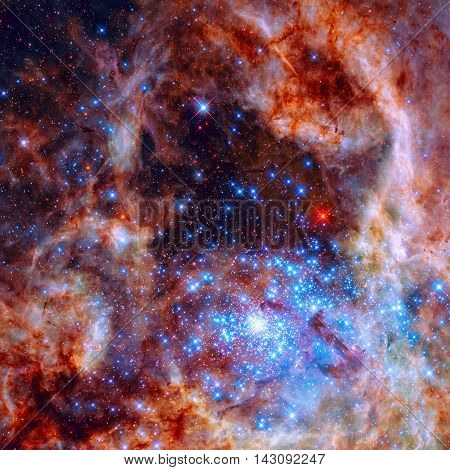 Central region of the Tarantula Nebula in the Large Magellanic Cloud. The young and dense star cluster R136. Retouched colored image. Elements of this image furnished by NASA.