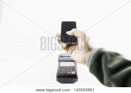 Mobile payment and omnichannel for business money by hand hold mobile pay with terminal on white background with clipping path.