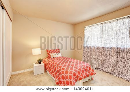 Modern Teen Bedroom Interior With Red Bedding.