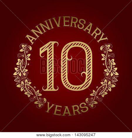 Golden emblem of tenth anniversary. Celebration patterned sign on red.