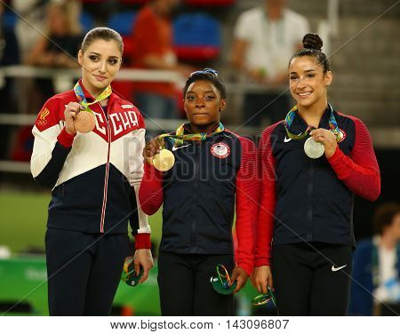 RIO DE JANEIRO, BRAZIL - AUGUST 11, 2016:Women's all-around gymnastics winners at Rio 2016 Olympic Games Aliya Mustafina of Russia (L), Simone Biles of USA and Aly Raisman of USA during medal ceremony