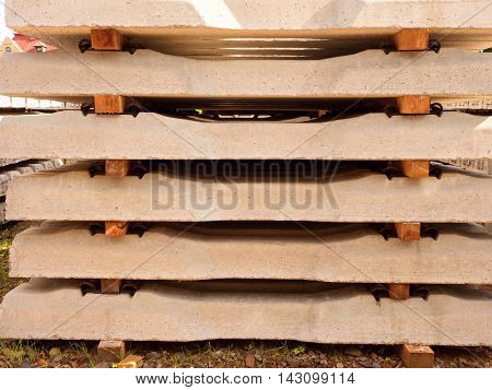 Sleepers Stock In Railway Depot. Concrete Railway Ties Stored For Reconstruction