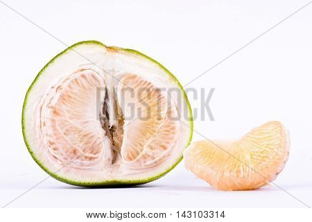 fresh pomelos peeled  and half pomelos on white background healthy fruit food isolated