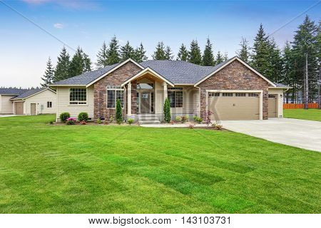 Luxury One Level House Exterior With Brick Trim And Garage