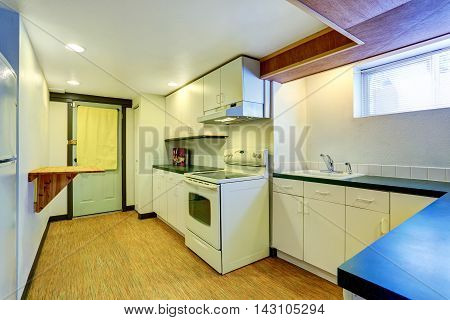 White Basement Kitchen Room With Green Counter Tops