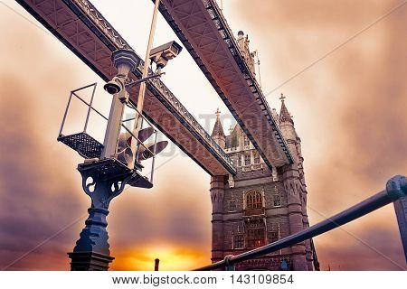 View Of Tower Bridge In London And Traffic Light That Regulates The Drawbridge