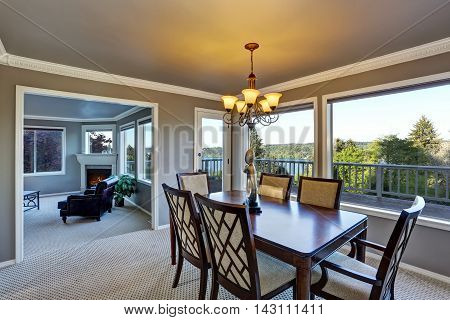 Open Floor Plan Dining Area With Perfect Water View Through Windows