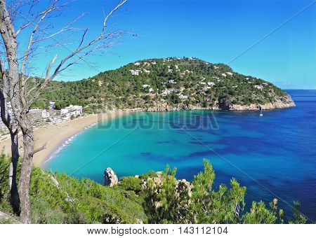 Beach of Cala San Vicent on Ibiza Island with turquoise water and no people.